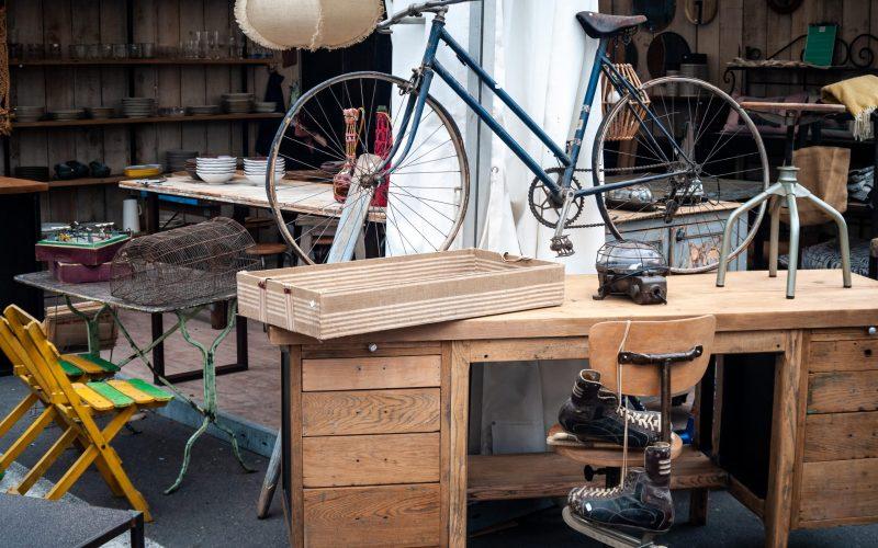 bicycle & ice skates on an out side antique market , L'isle sur la sorge ,France.